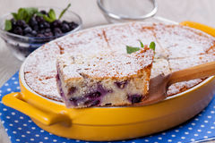 Semolina cake with berries, slice on a wooden spatula. Semolina cake with berries, slice close up Royalty Free Stock Photography