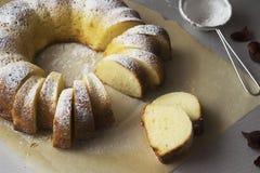 Semolina cake with cream cheese. Sponge cake semolina with cottage cheese sprinkled with icing sugar Stock Image