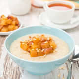Semolina with caramelized peaches, close-up Stock Image
