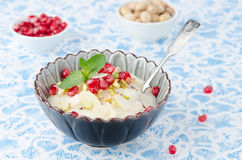 Semolina dessert with pomegranate seeds and pistachios in a bowl Royalty Free Stock Images