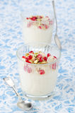 Semolina dessert with pomegranate seeds and pistachios in a glas Stock Photography