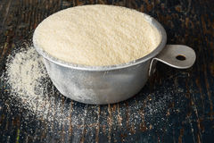 Semolina Flour. In a vintage measuring cup royalty free stock images