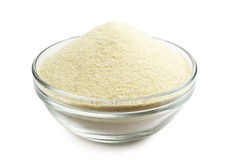 Semolina in a bowl. Semolina in a glass bowl on a white background Stock Image