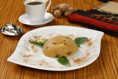 Semolina halva, halvah, halava. Traditional Turkish semolina sweet desert halva  irmik Royalty Free Stock Images