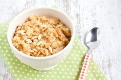 Semolina halvah with pine nut. Semolina halvah, halva on a white background Royalty Free Stock Photo