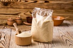 Semolina in packing and bowl on a wooden background. Healthy die. Tary cereals concept Stock Image