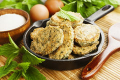 Semolina pancakes with nettle stock images