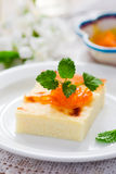 Semolina pie   on a white plate for breakfast Royalty Free Stock Photos