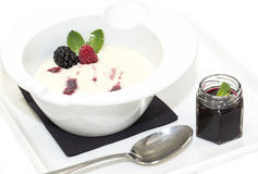 Semolina. Porridge with berries decorated with berry jam Royalty Free Stock Images