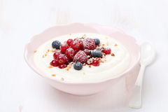 Semolina porridge with berries and nuts, horizontal Royalty Free Stock Photo