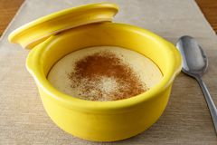Semolina porridge with cinnamon. In a yellow saucepan stock photography