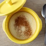 Semolina porridge with cinnamon. In a yellow saucepan royalty free stock image
