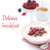 Semolina porridge with fresh berries, nuts and cup of coffee Royalty Free Stock Photography