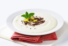 Semolina porridge with grated chocolate and lemon curd Stock Photo