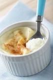 Semolina pudding. In the ramekin on the blue napkin Stock Photos