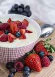 Semolina Pudding in a bowl with berries Royalty Free Stock Image