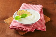 Semolina pudding with fresh apple Stock Photos