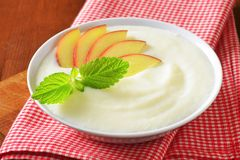 Semolina pudding with fresh apple Stock Image