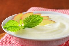 Semolina pudding with fresh apple Royalty Free Stock Image