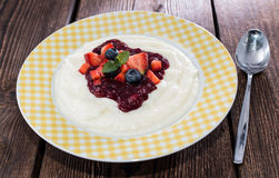 Semolina Pudding. Topped with fresh berries Royalty Free Stock Photography