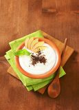 Semolina or rice pudding with apple and chocolate Stock Photos