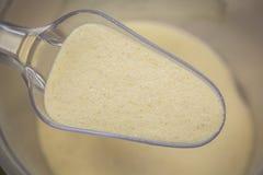 Semolina. Scoop of Semolina. Finely ground grits. Manna-croup Stock Image