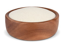Semolina in a wooden bowl. Cream wheat in a wooden bowl on  white background Stock Photos