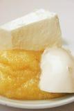 Semoule de maïs, fromage et crème Photo stock