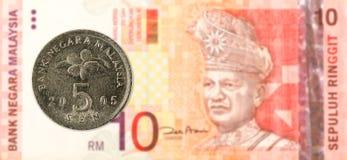 sen mynt för 5 malaysian mot sedel för ringgit för malaysian 10 royaltyfria foton