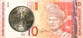 sen mynt för 20 malaysian mot sedel för ringgit för malaysian 10 arkivfoto