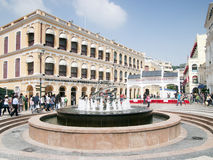 Senado square , Macao. Tourists visiting fountain at Senado square , Macao Royalty Free Stock Image