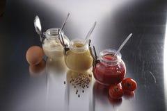 Senap, ketchup och mayonnaise royaltyfri fotografi