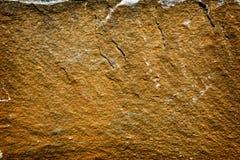 Senap & rost färgad sten royaltyfri bild