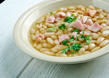 Senate bean soup. Soup made with navy beans, ham hocks, and onion.served in the dining room of the United States Senate Royalty Free Stock Images