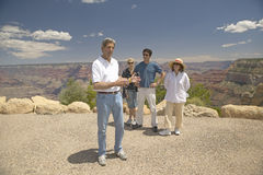 Senator John Kerry, with family,  speaking at rim of Bright Angel Lookout, Grand Canyon, AZ Stock Photo