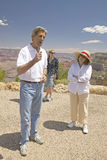 Senator John Kerry, with family,  speaking at rim of Bright Angel Lookout, Grand Canyon, AZ Royalty Free Stock Image
