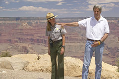 Senator John Kerry speaking with ranger at rim of Bright Angel Lookout, Grand Canyon, AZ Royalty Free Stock Photography