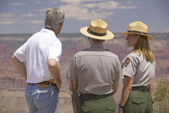 Senator John Kerry speaking with 2 rangers at rim of Bright Angel Lookout, Grand Canyon, AZ Royalty Free Stock Photography