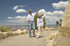 Senator and Mrs. John Kerry walking down path and waving at rim of Bright Angel Lookout, Grand Canyon, AZ Royalty Free Stock Image
