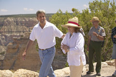 Senator and Mrs. John Kerry walking with rangers at rim of Bright Angel Lookout, Grand Canyon, AZ Stock Photos