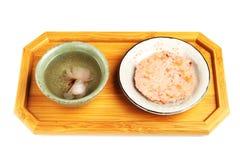 Senbei de Sakura e chá de sakura Imagem de Stock