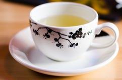Sencha tea in a white cup Royalty Free Stock Photos