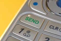 Send. A closeup of the send button on a cellphone Stock Images