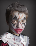 Send in the Clowns. A young clown in full makeup stock images