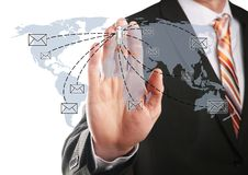 Send an email. Businessman send an email to his contacts Royalty Free Stock Images