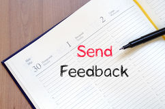 Send feedback concept on notebook. Send feedback text concept write on notebook stock photography
