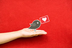 Send heart to you on a hand Stock Photography