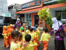 Send mail. Kindergarten students are learning to send mail at a post office in Sukoharjo, Central Java, Indonesia Stock Photo