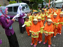 Send mail. Kindergarten students are learning to send mail at a post office in Sukoharjo, Central Java, Indonesia Stock Images
