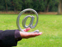 Send a message. An at symbol held by an executive Royalty Free Stock Image